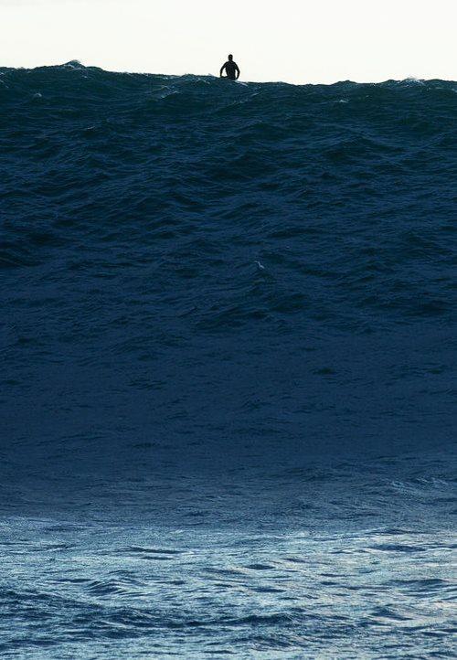 Surfer on top of wave